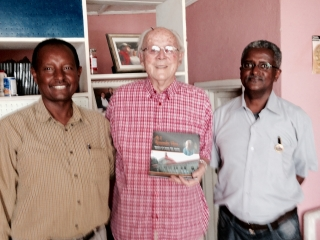 Father Turenne with his book with Garedew and Mizan Kristos jpg